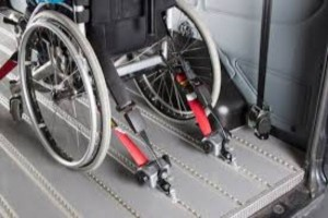 Wheelchair restraining systems